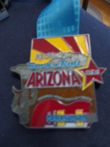 The first of the four Rock 'n' Roll Arizona puzzle piece medals