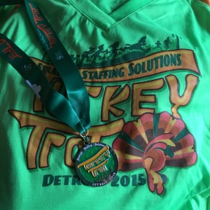 This years shirt is definitely on trend, as current running styles favor neon for visibility