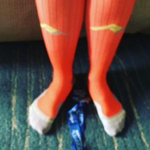 Post-race, rocking my Pro Compression socks in BibRave Orange with A Major Award!