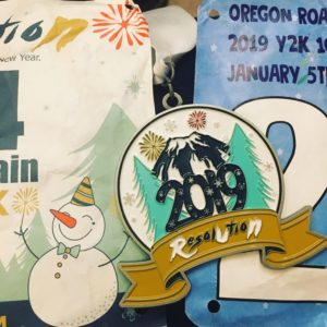 medal and two race bibs