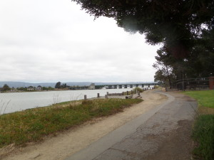 Standing at the end of Packet Landing Road, looking down the trail towards the bridge between Alameda and Bay Farm Island.