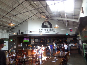 The bar and part of the open-barn structure at Golden Road Brewing