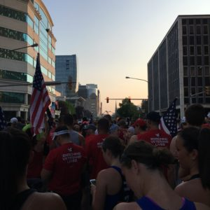 Team RWB raises the flags at the starting line
