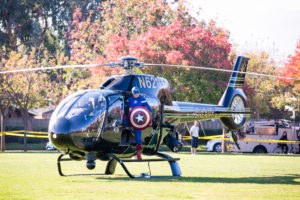 Captain America arrives by helicopter to start the kids' races, of course (photo courtesy of the Heroes Run and ©2016 Photography By Busa)