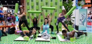 Sweat Pink squad with foam rollers and yoga mats at the La Croix booth
