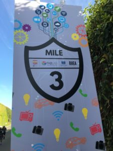 Mile 3 mile marker sign, with technology-themed icons