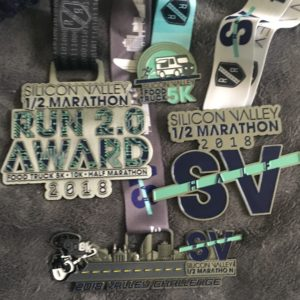 All of the medals from the Food Truck 5k and Silicon Valley Half, including the bonus bling