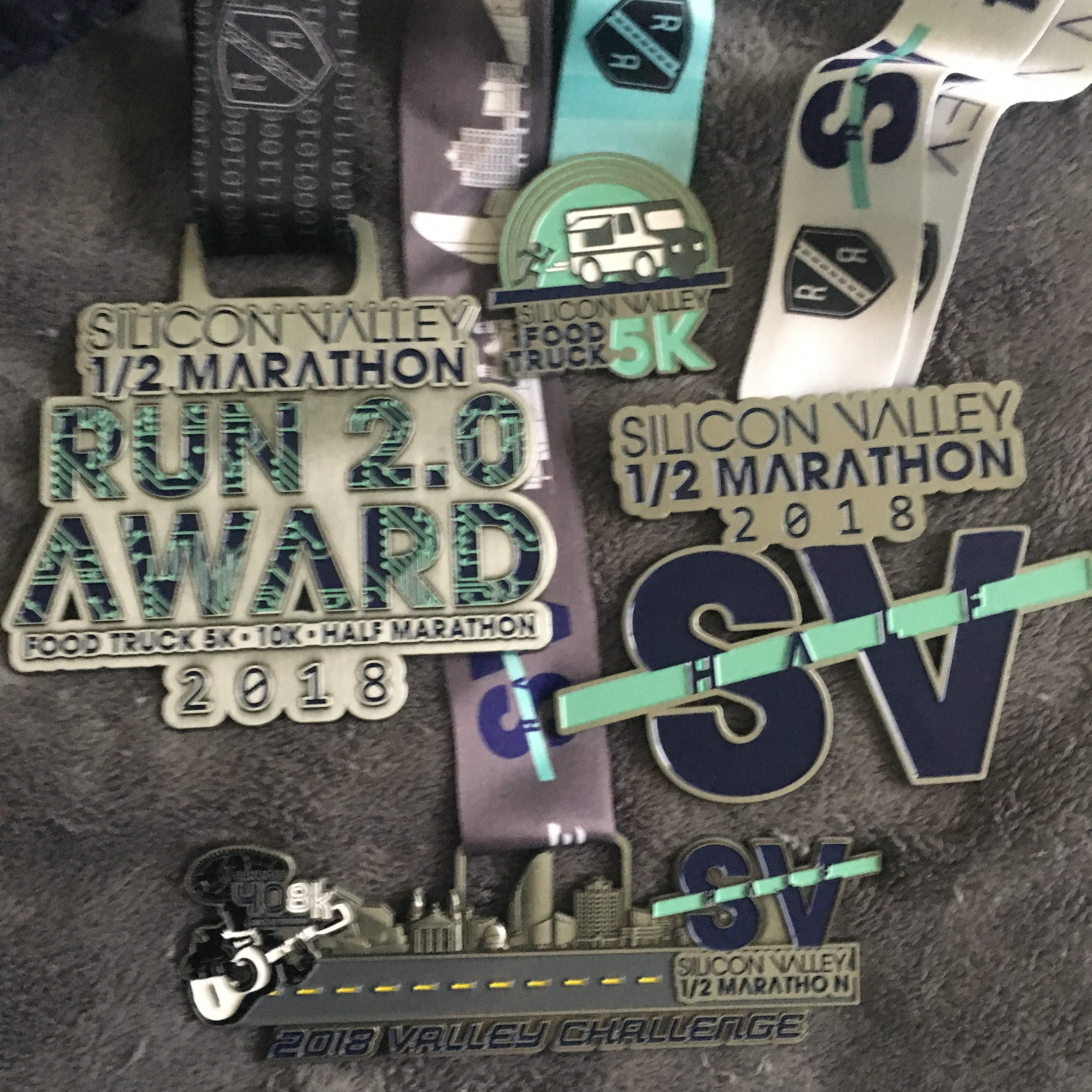 Here\'s the bling from the Inaugural Food Truck 5k and Silicon Valley Half Marathon, and a review. Have you signed up for next year?