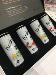 display box of four cans of fizzique